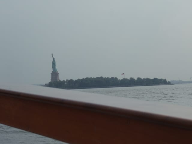 I like how Lady Liberty is falling off the edge of the photo, like she was seasick too.