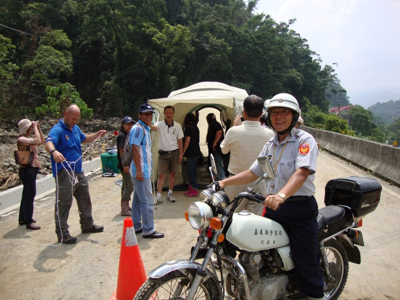 I love this photo, of the local police chief of Lai Chi and the demo tent we set up for them.