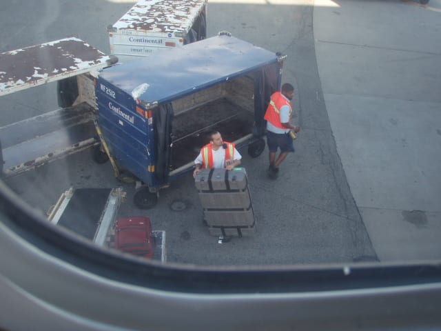 My bike, Grub, and The Other One get loaded into the belly of our plane.