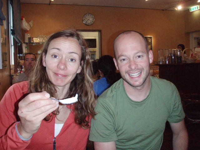 Lara resorts to spoon for her egg. Jim thinks this is so funny that he's squinting.