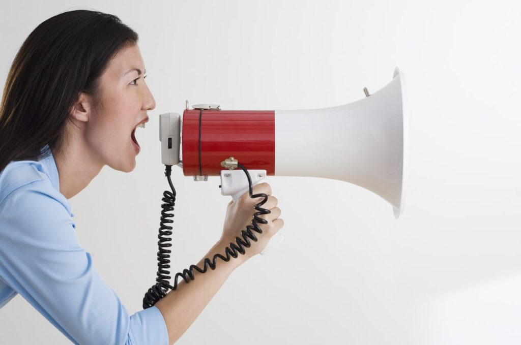 Woman Shouting with Bullhorn --- Image by © Royalty-Free/Corbis