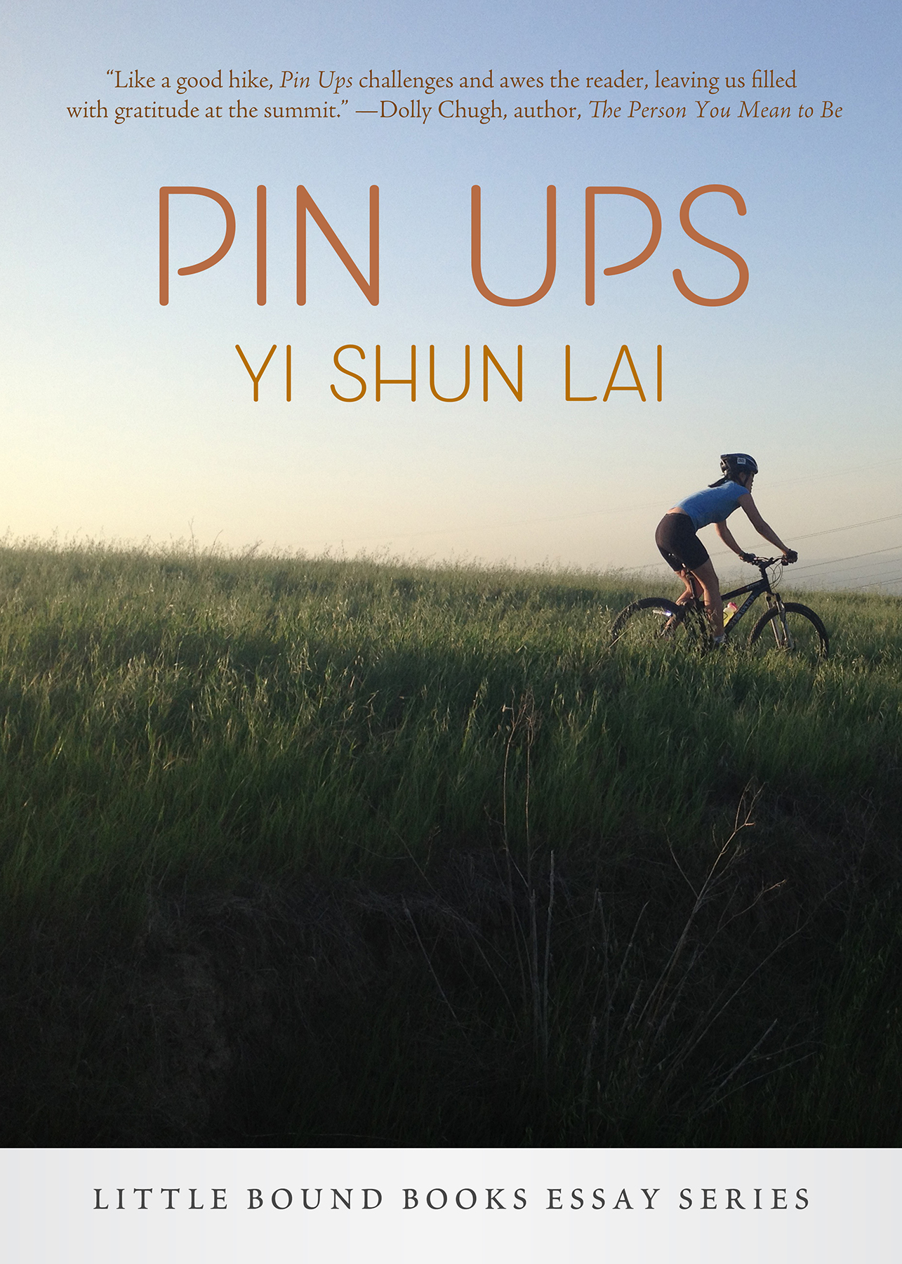 Cover of book; woman riding on mountain bike down grassy slope